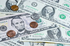 American Dollar bills with coins Stock Images