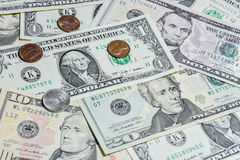 American Dollar bills with coins royalty free stock image
