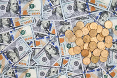 American 100 dollar bills and coins Royalty Free Stock Photos