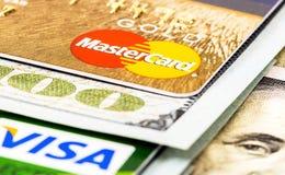 American dollar bills with credit cards Visa and MasterCard. SAMARA, RUSSIA - NOVEMBER 15, 2015: American dollar bills with credit cards Visa and MasterCard royalty free stock photo