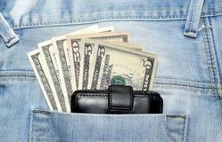 American dollar bills in jeans pocket Royalty Free Stock Photo