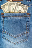 American dollar bills in jeans pocket Royalty Free Stock Images