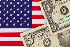 American dollar bills on a Stars and stripes flag. American dollar bill banknotes on an American stars and stripes flag Stock Images