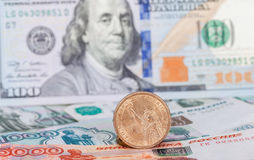 American dollar coin over banknotes Stock Image