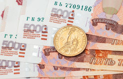 American dollar coin over russian banknotes Stock Photo