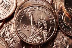 American Dollar Coin Reverse. A pile of US presidential dollar coins with the focus on one coin showing the reverse side featuring the Statue of Liberty Stock Photos