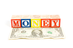 American dollar with money on wooden blocks. Over white royalty free stock image