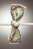 American Dollar Tied in Rope. Wrinkled American Dollar Tied Up in Rope Stock Photo