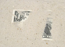 American dollar under sand Stock Photography