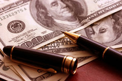 American dollars. Dollars and pen Stock Image