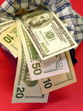 American dollars. In the bag isolated on red stock photos