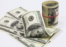 The american dollars. Roll of banknotes and separate banknotes in 100 US dollars Stock Photos