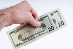 American dollars. In mans hand royalty free stock image