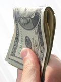 American dollars. Hand holds a fold of American $20 bills Stock Image