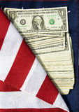 The American dollars on the American flag. Photo of one-dollar banknotes on a national American flag Royalty Free Stock Photos