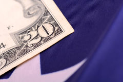 American dollars on american flag Royalty Free Stock Image