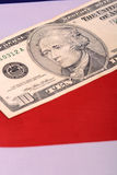 American dollars on american flag. Close up Royalty Free Stock Photo