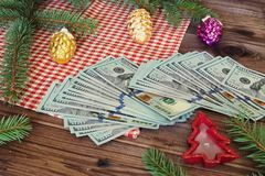 American dollars as a Christmas gif t or a Christmas spending concept Royalty Free Stock Photography