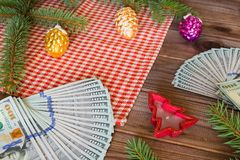 American dollars as a Christmas gif t or a Christmas spending concept Royalty Free Stock Photo