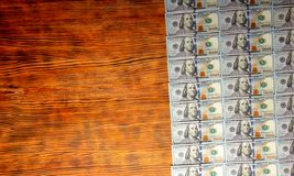 American dollars bills on wooden background. Top view, copy space close up royalty free stock photo