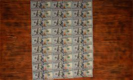 American dollars bills on wooden background. Top view, copy space close up stock photo
