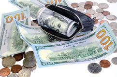 American dollars in black purse and coins on a white background. Royalty Free Stock Photos