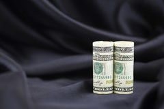 American dollars with black satin background reflect sophisticat Stock Photography