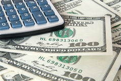 American dollars and calculator close-up Stock Images