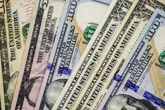 American dollars cash money. background from US dollars. different banknotes stock photo