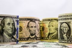 American dollars cash money. background from US dollars. different banknotes stock image
