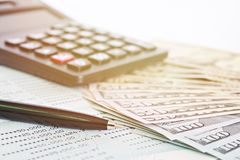 American Dollars cash money, calculator and savings account passbook or financial statement on table. Business, finance, investment, savings or accounting Royalty Free Stock Images