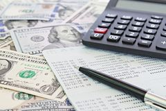 American Dollars cash money, calculator and savings account passbook or financial statement on table. Business, finance, investment, accounting or money exchange Stock Photo