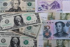 American dollars and Chinese as a background. American dollars and Chinese yuan are laid out side by side as a background royalty free stock photo