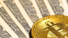American dollars and coin of Bitcoin crypto currency