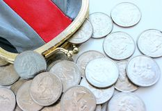 American dollars in a coin purse on a white background. Stock Images