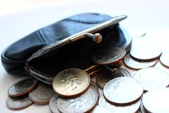 American dollars in a coin purse on a white background. Close-up. Royalty Free Stock Images