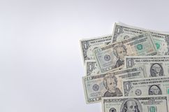 American dollars in a corner on white background. American dollars are laid out in a corner of the picture on white background royalty free stock photos