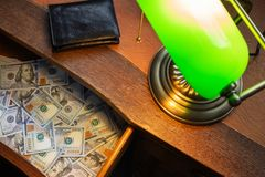 USA dollars, in a desk drawer royalty free stock photo