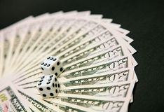 American dollars and dice Stock Photo