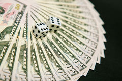 American dollars and dice Stock Photos