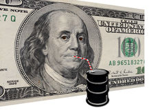 American dollars drinking oil Stock Images