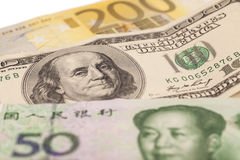 American dollars, European euro and Chinese yuan bills Royalty Free Stock Photo