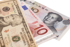 American dollars, European euro and Chinese yuan bills Royalty Free Stock Photos