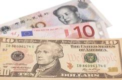 American dollars, European euro and Chinese yuan bills Stock Photography