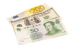 American dollars, European euro and Chinese yuan bills Stock Images