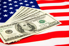 American dollars and flag. Stock Photography