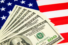 American dollars and flag. Royalty Free Stock Photo
