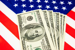 American dollars and flag. Royalty Free Stock Image