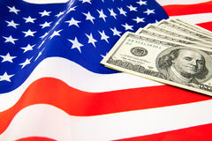 American dollars and flag. Stock Images