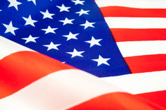 American dollars and flag. Royalty Free Stock Photography